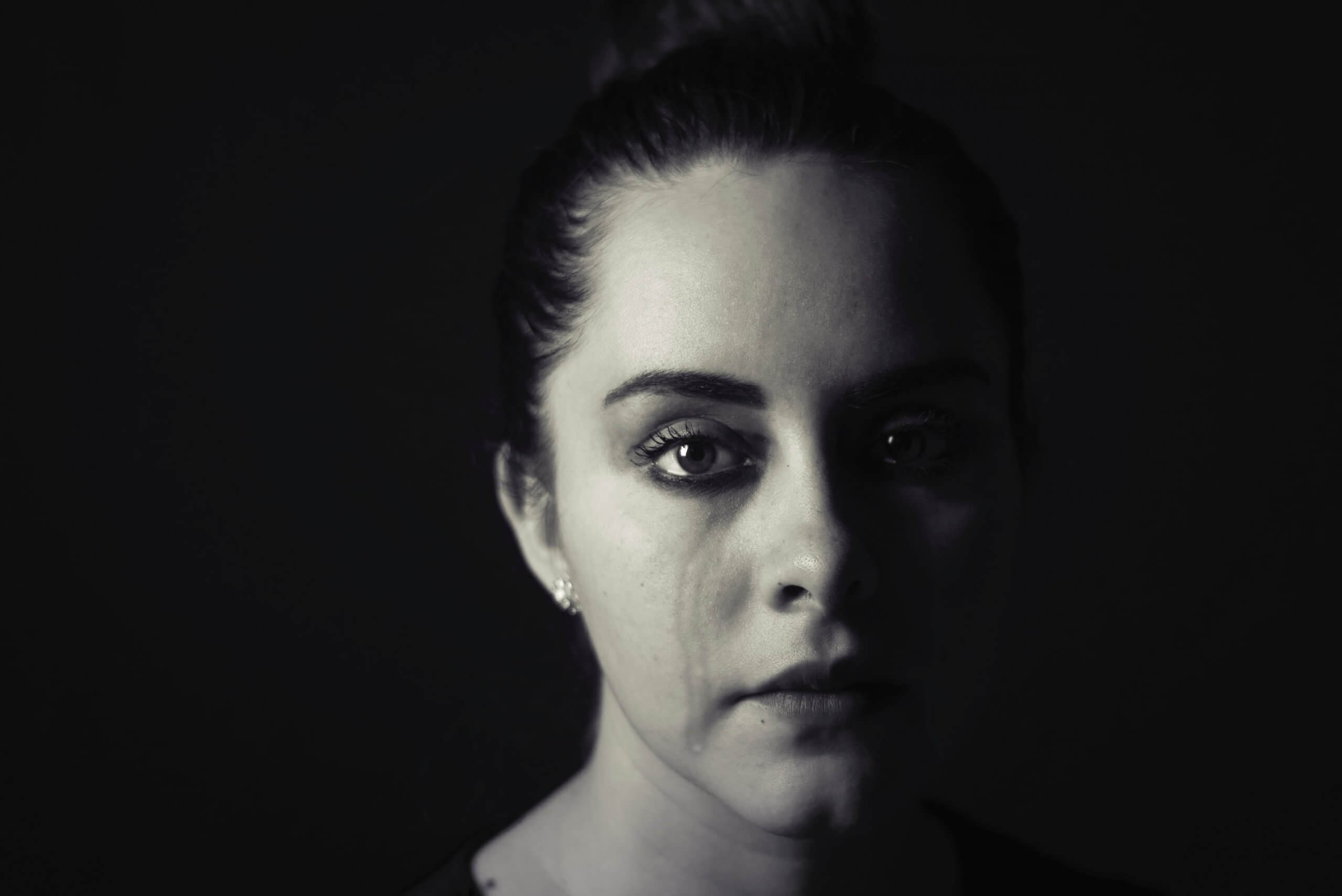 Woman crying, black and white